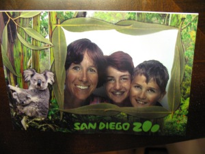 Zoo staffers took our photo which I was going to buy in electronic form until I found out it was $45!  So we went in a photo booth ($5) at the zoo, and I took a picture of the bent-up photo when we got home.