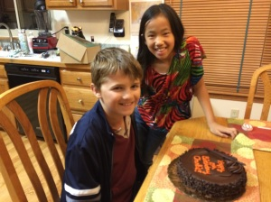 Charlie and his cousin Rachel with the flourless chocolate cake that Aunt Barb & Uncle Ray bought him