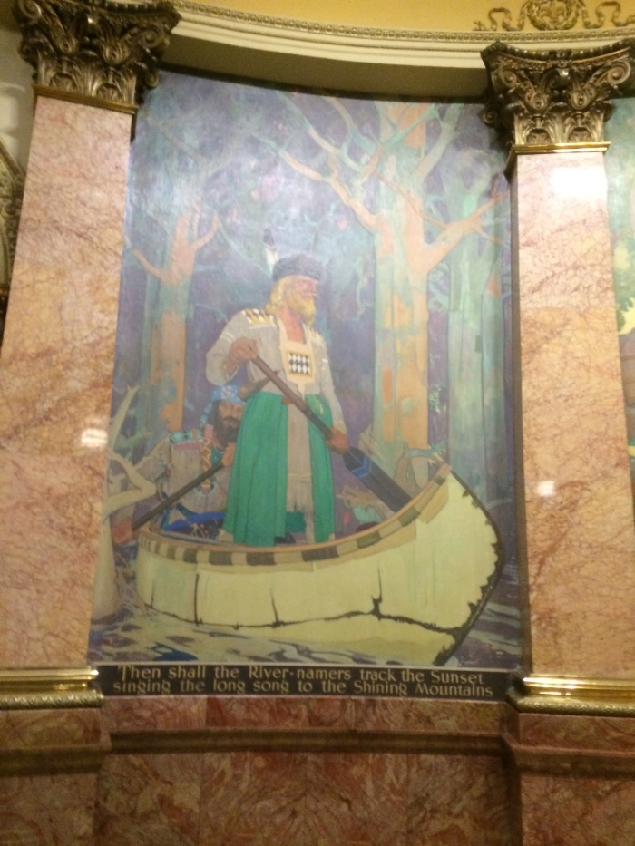 There are some crazy murals at the capitol that we never noticed before today.  Underneath each of the eight paintings there's a  silly, non-sensical verse.  I'm not sure what's being portrayed here...viking wearing a dress and coon-skin cap in a canoe with a Mediterranean guy behind him...