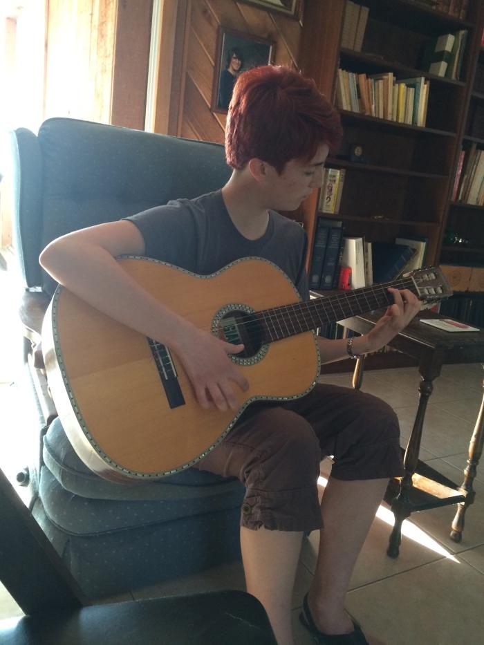 Laurel plays one of three guitars she found at Grandma's & Grandpa's house