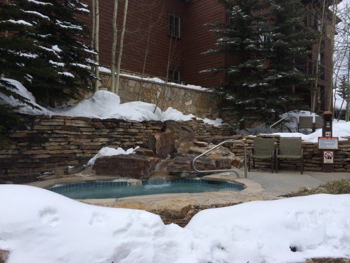 One of the outdoor hot tubs at Grand Timber Lodge