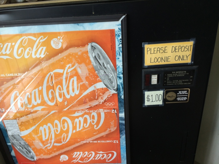 "This Coke machine at the laundromat is about the only scenery I've been enjoying recently.  A ""loonie"" is a one-dollar coin (They don't have bills smaller than a five in Canada.) so named because of the loon (bird) that appears on some of them.  Even though we've been here a month, I still think in American mode sometimes.  When I got change for the washers and dryer yesterday, I placed my quarters on top of the washer and caught a glimpse of one of them.  ""Oh man!  I got a Canadian quarter,"" I thought and then realized that was a good thing."