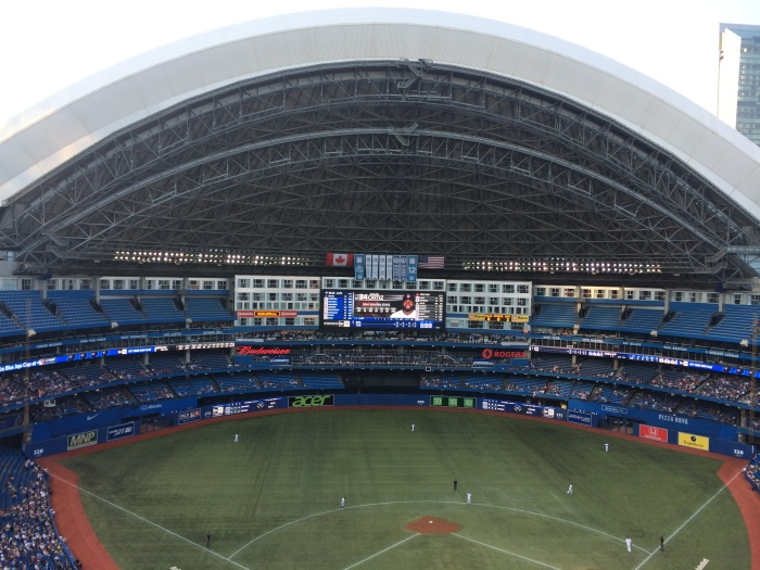 Rogers Centre (Rogers is a wireless carrier in Canada.  It's the same company the Vancouver arena was named for where the kids went to the Queen concert.), formerly Sky Dome, where we watched the Blue Jays play the Red Sox