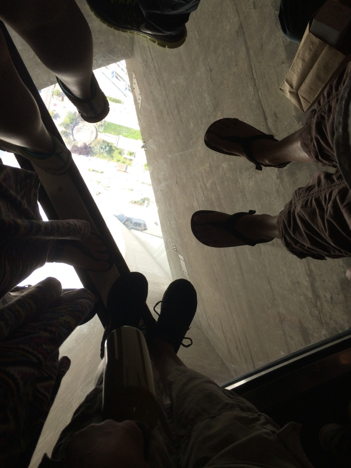 Standing on the very-busy glass floor segment at the CN Tower