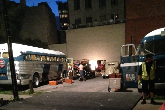 Laurel went downstairs and outside briefly while they were shooting the movie and took this picture.  She says the man in brown fringe standing by the bus is Jason Sudeikis.