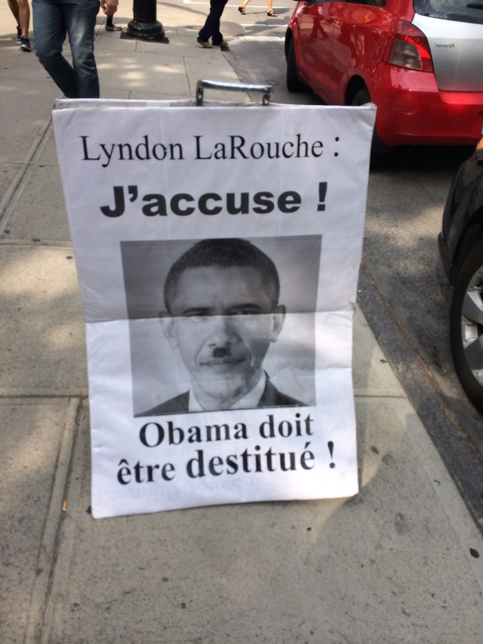 I saw this when Charlie and I were running errands today.  (Laurel wasn't feeling well and didn't go with us.  She perked up considerably when the movie started shooting.)  I don't know why Lyndon LaRouche is badmouthing Obama in Canada.  I didn't even know LaRouche was still alive.  (Wikipedia says he's 91.)  This photo of Obama with the Hitler mustache seemed particularly weird today since Jesse Owens, who dealt with Hitler's racism at the 1936 Berlin Olympics, is having a movie made about him here.