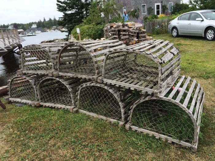Lobster traps used to be made of wood and look like these.  Although they're now made of metal, the design of the trap inside is the same.