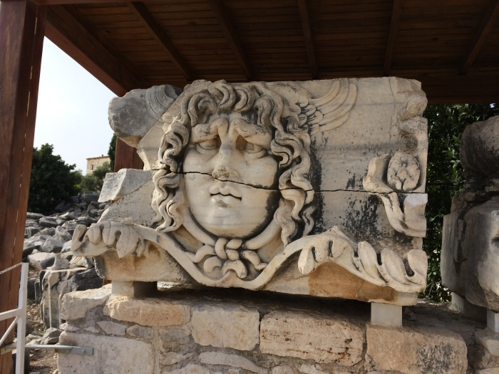 "The face of Medusa was carved into pieces of the marble (now on the ground) that went over the columns of Apollo's temple.  Medusa warded off bad spirits and bad emotions such as jealousy before people entered.  The eye of Medusa is a popular amulet in Turkey with the ""eye"" jewelry and household wallhangings for sale everywhere."