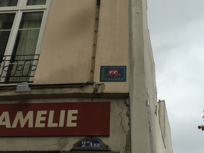 "From our ""Off the Beaten Path"" Tour: Ludovic, our tour guide, pointed out these space-invader tile graffiti/artwork on a number of buildings.  We've since seen them on buildings in other arrondisements.  He said they started showing up on Parisian buildings in the early 1990's."