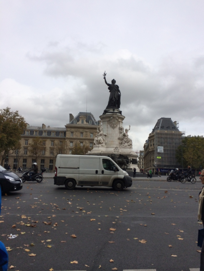 Place de la République with the words of the French motto inscribed around the base: Liberté, Égalité, Fraternité.  In the block to the right of this monument is a McDonald's and a KFC.