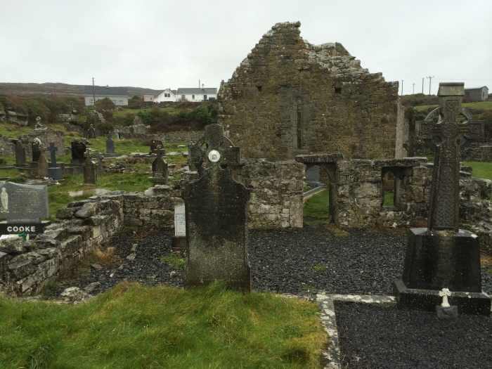 A cemetery on Inishmoor - the ancient-looking tombs are from the 20th century (but the building/ruin is much older).